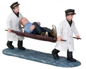 Dickensville Gevallen schaatser op brancard