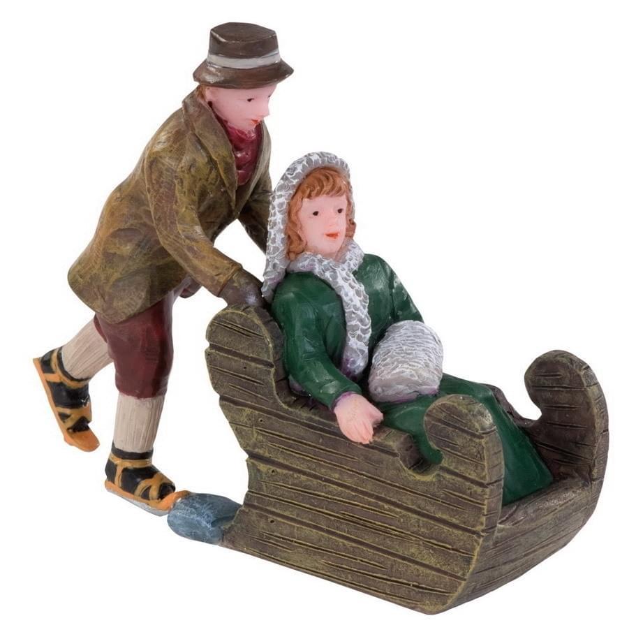 Dickensville Man duwt vrouw in houten slee