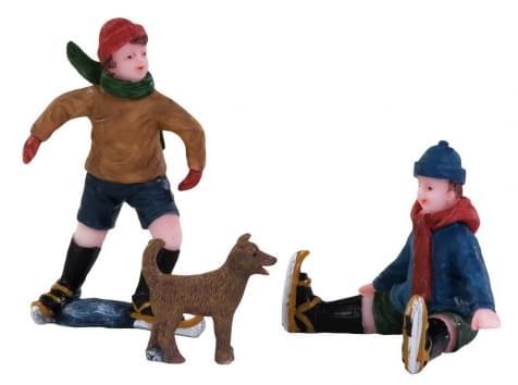 Dickensville Jongens en hond op het ijs